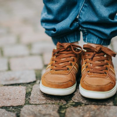 Close up image of fashion lace shoes on kid's feet